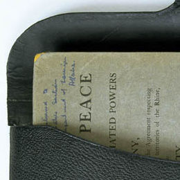 Detail of the black leather satchel containing Australia's copy of the Treaty of Versailles.