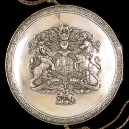 This silver case contains the wax seal with the Royal insignia.