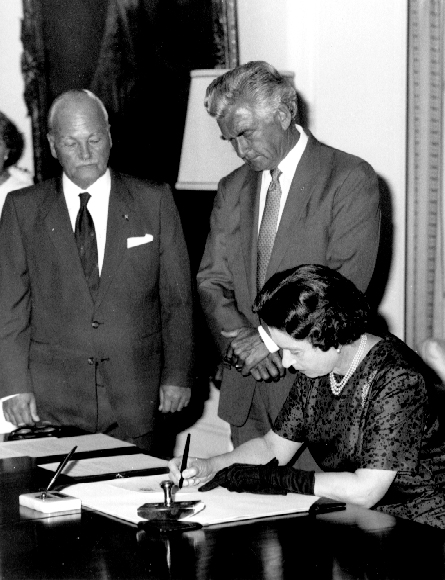 Queen Elizabeth II signs the Proclamation of the Australia Act